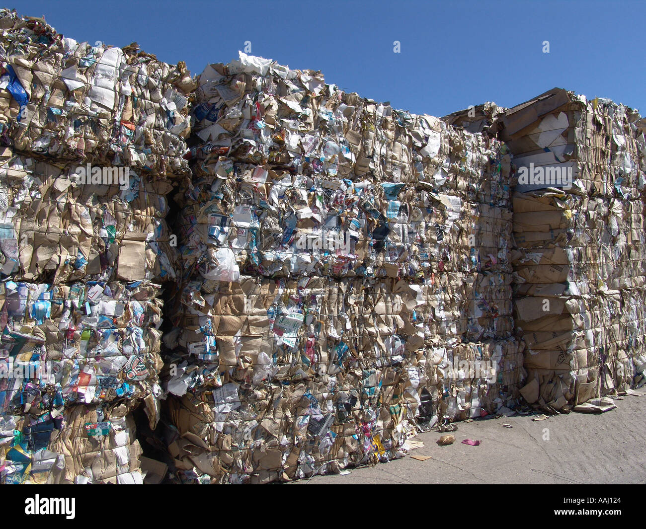 recycled bales of waste paper awaiting shipping to be pulped