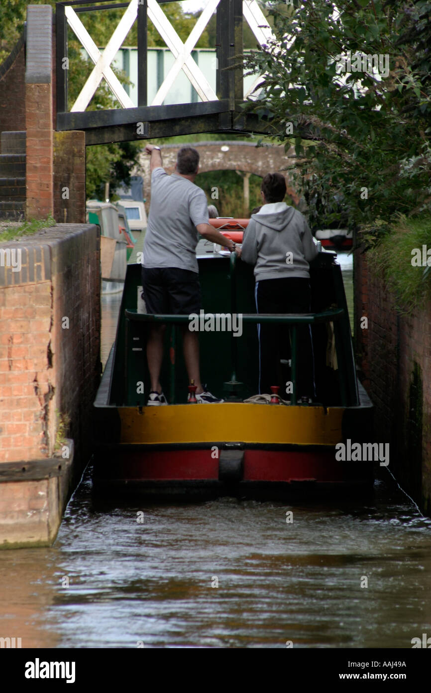 Narrowboat negotiating the Link at Kingswood Junction Stratford and Grand Union Canal Junction - Stock Image