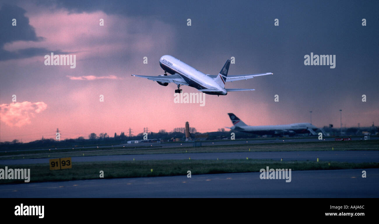 Passenger jet aircraft taking off from Heathrow airport - Stock Image