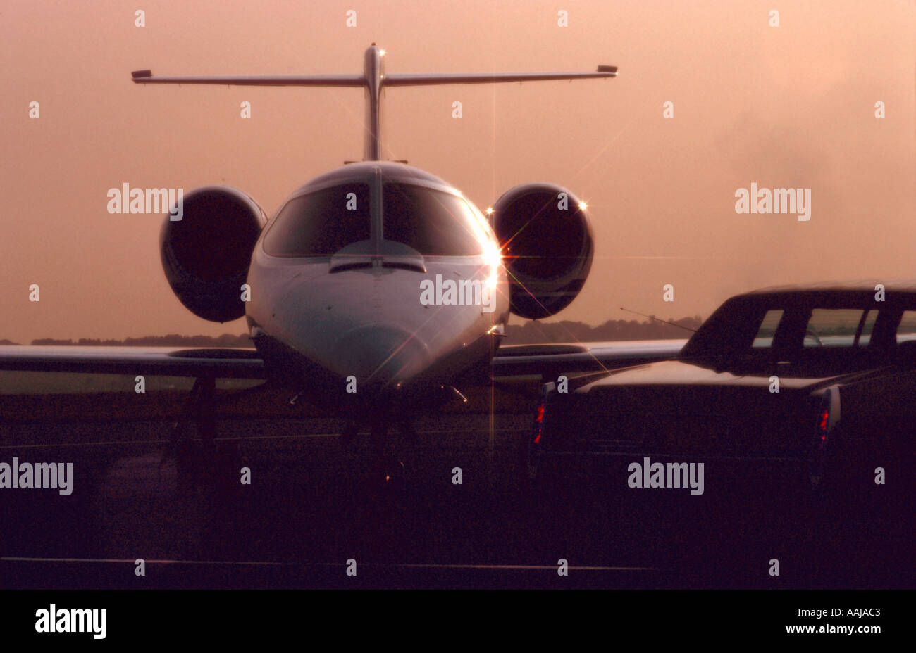 Executive Lear jet at sunset - Stock Image