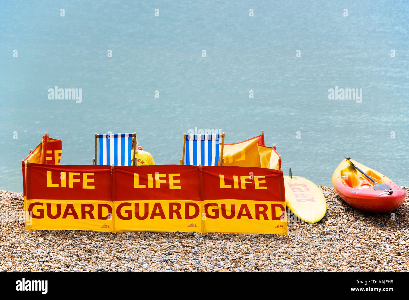 Life guards on a beach at Brighton England - Stock Image