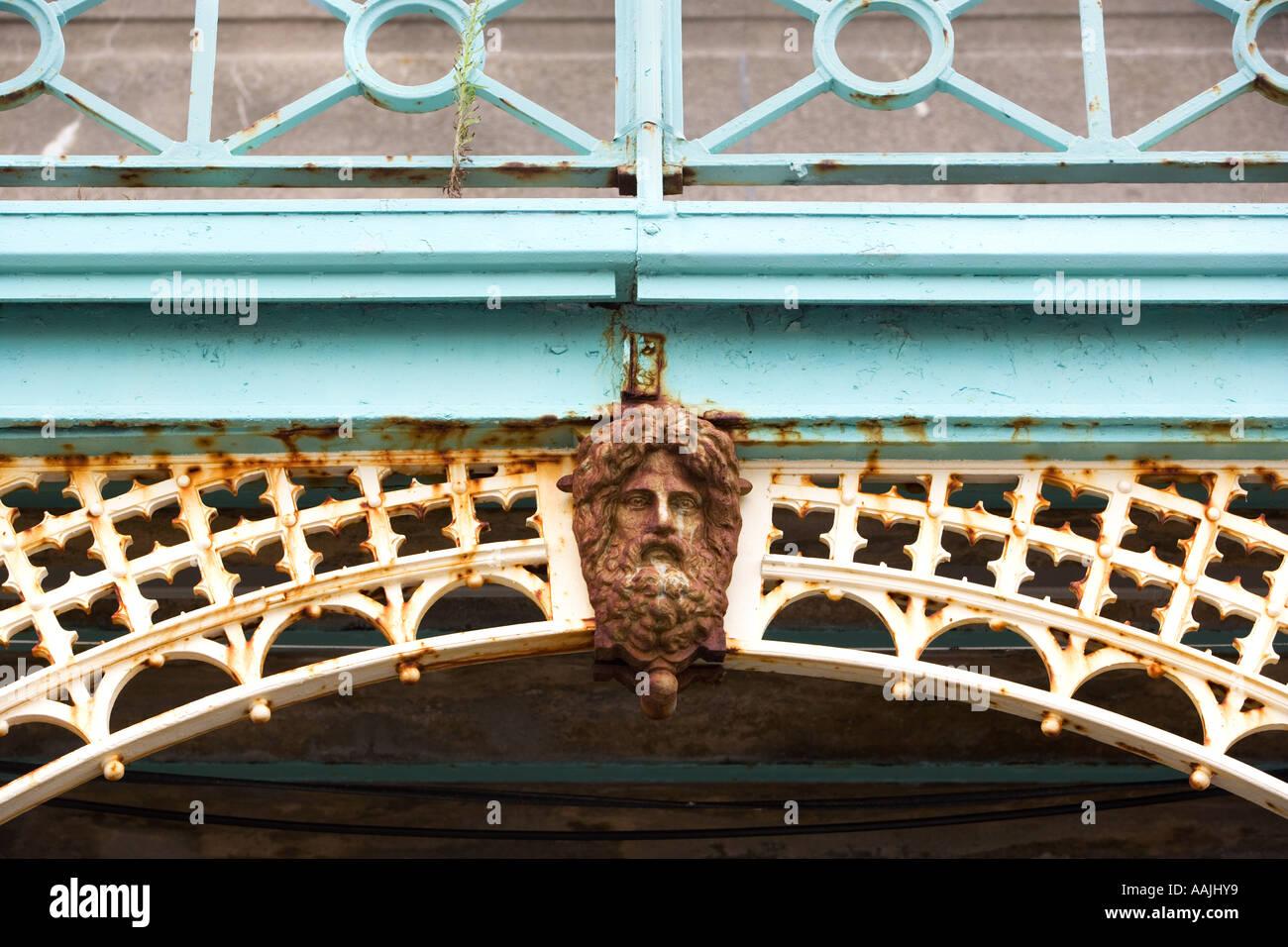 Metal figurehead on cast iron railings in Brighton England - Stock Image