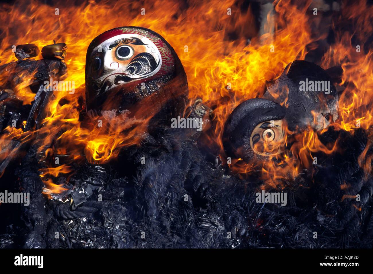 Burning daruma on New Years Day at Jindaiji Temple Chofu Tokyo Japan - Stock Image