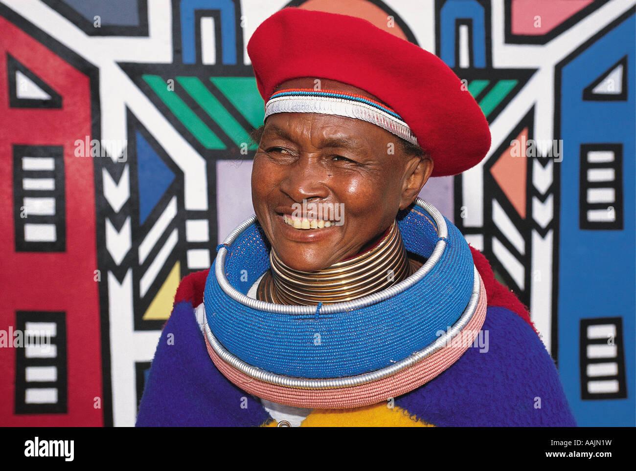 An African woman wearing Ndebele national dress Cultural Village Bronkhorstspruit Gauteng South Africa Stock Photo