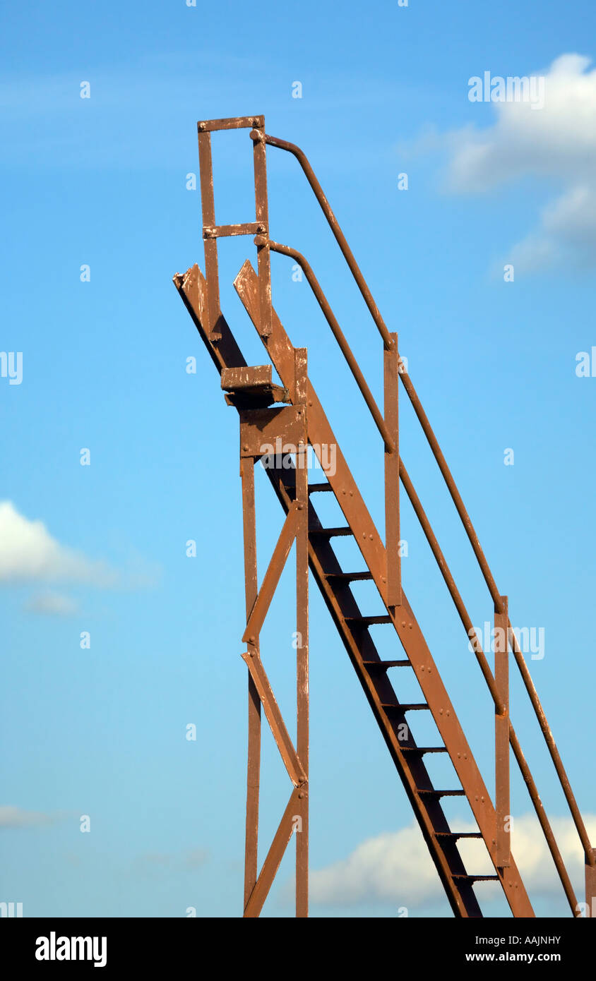 Metal stairway leading nowhere - Stock Image