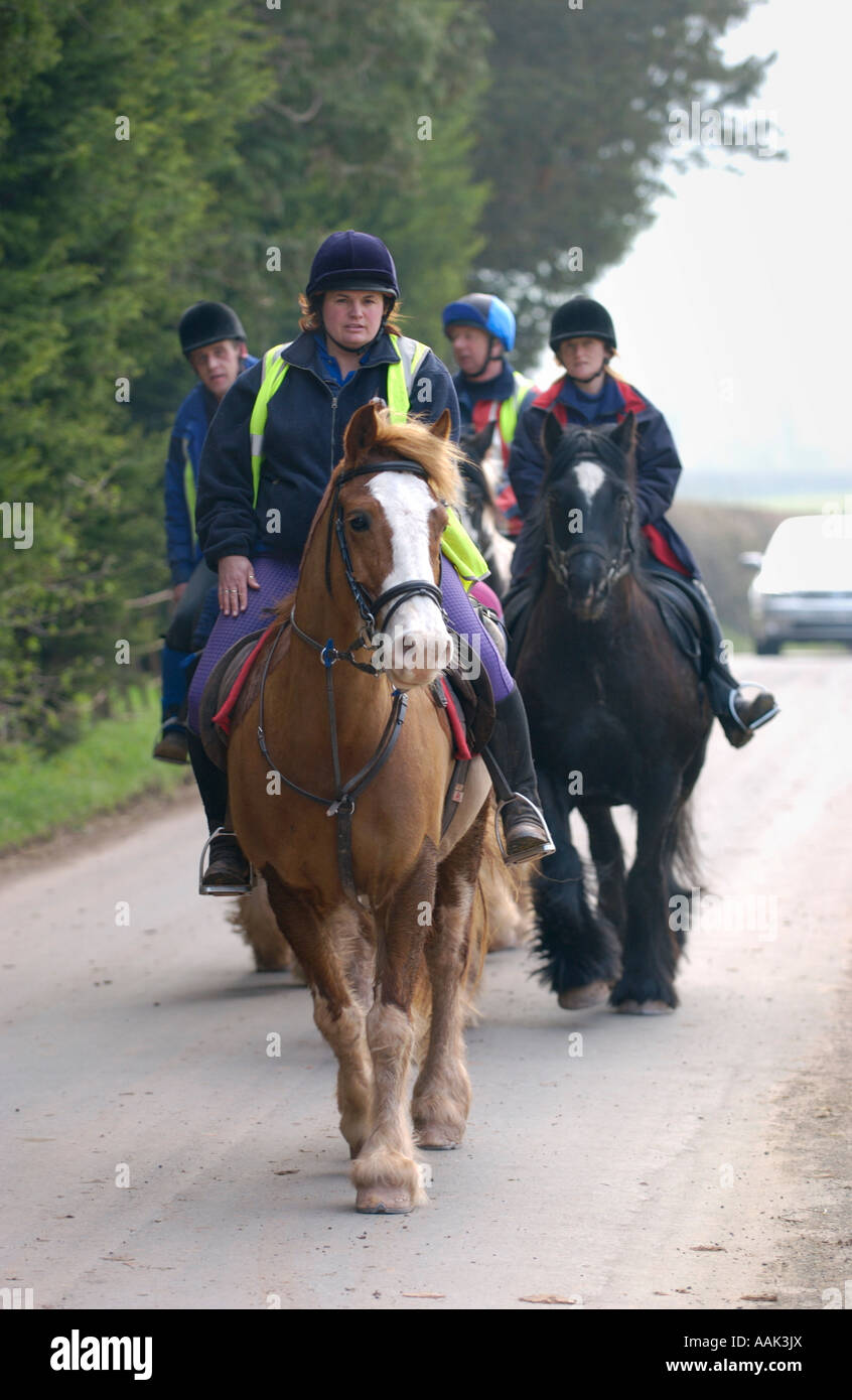 Pony trekkers riding down country lane on a Black Mountains riding loop from Tregoyd Mountain Riders Centre South - Stock Image