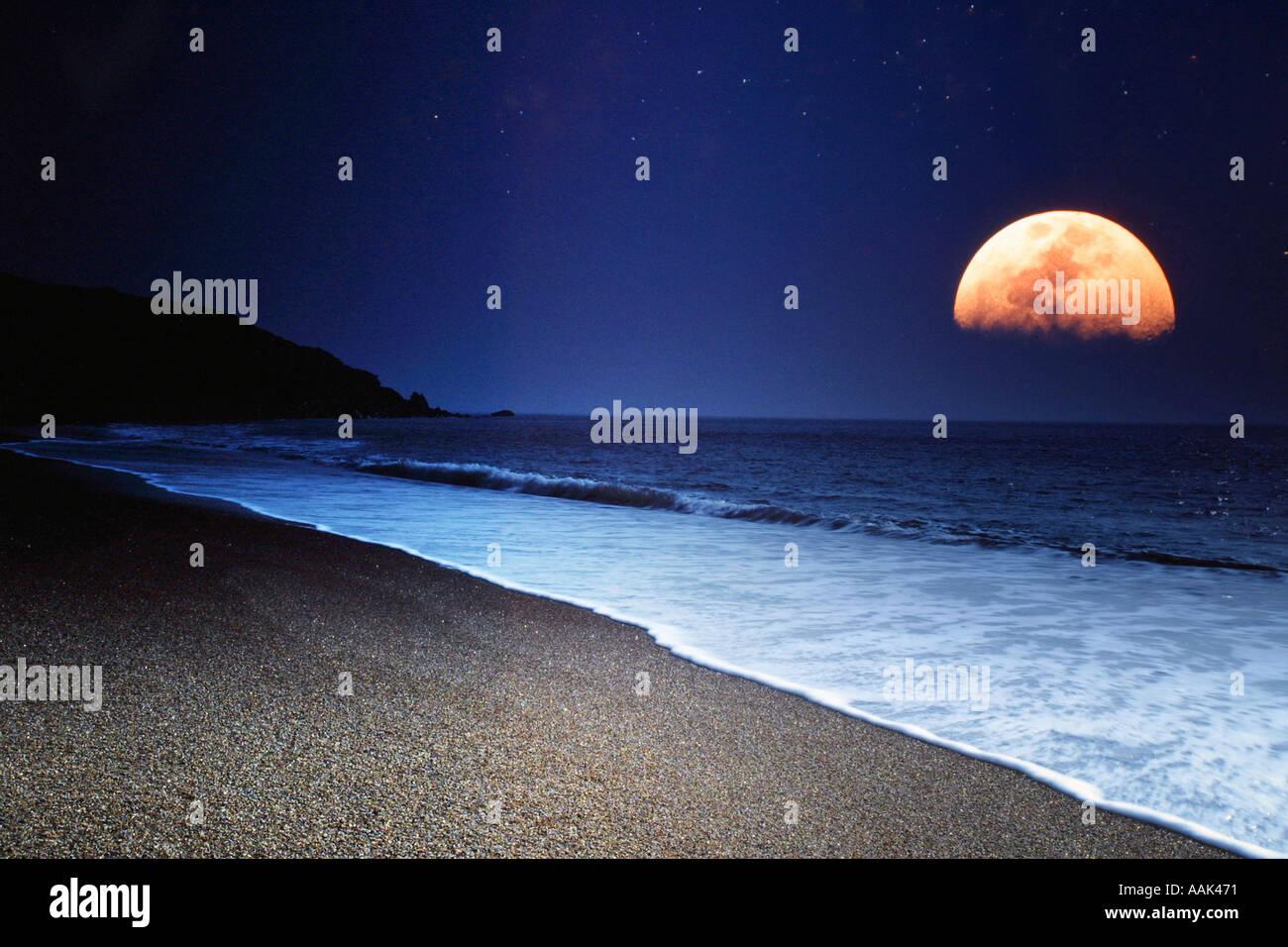 Moonrise over Beach Isle of Wight England UK - Stock Image