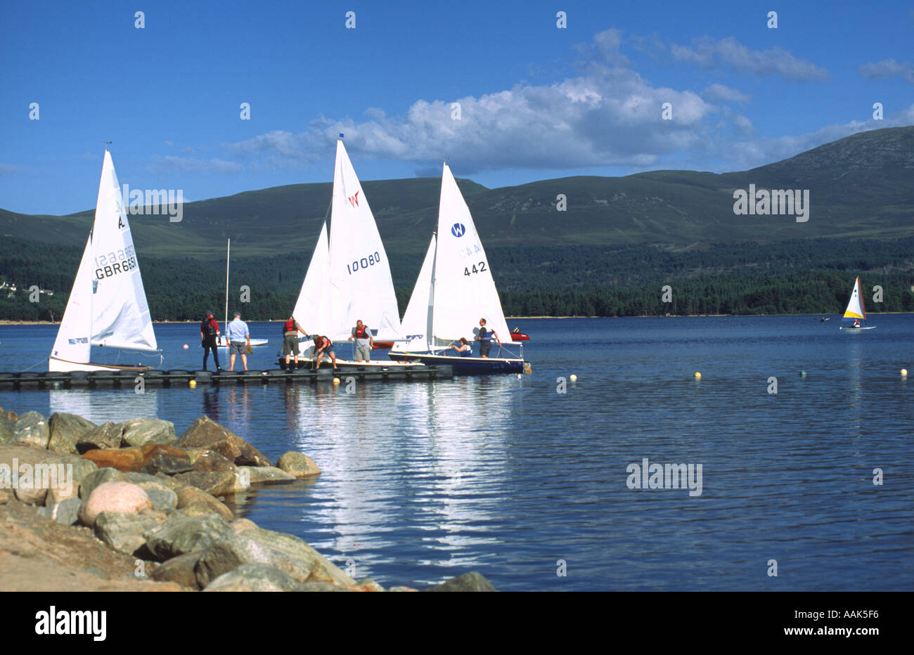 Sailing vessels returning to the mooring on Loch Morlich Cairngorms Scotland - Stock Image