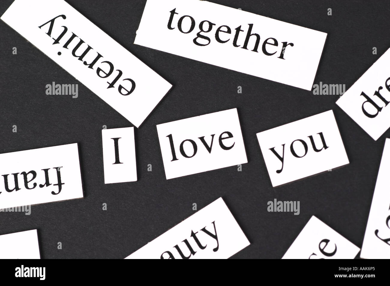 Magnetic Fridge Words Jumbled Up But With The Words I Love You In The Middle