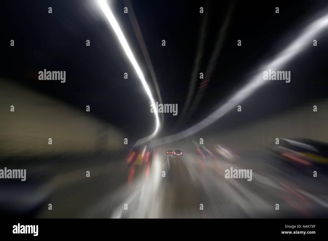 Zoom effect M-25 Orbital at night Tunnel London England United Kingdom - Stock Image