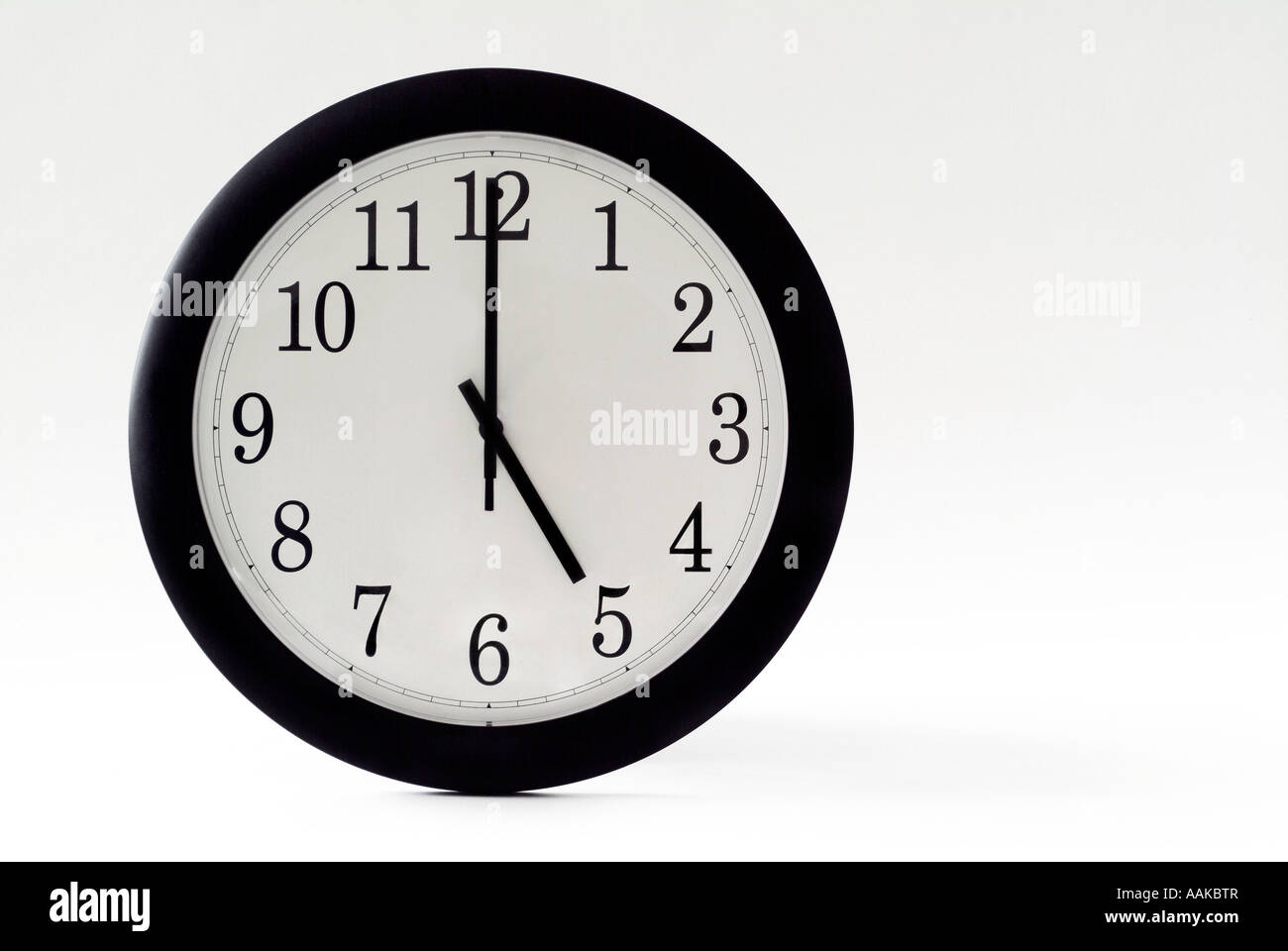 Five PM on the clock - Stock Image