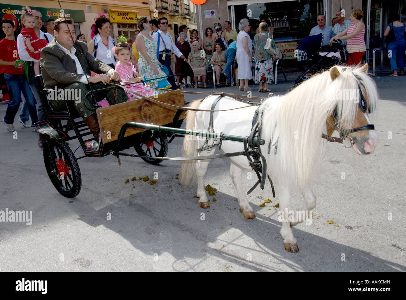 Father daughter travelling by pony trap to the Romeria in Coin Andalucia Spain - Stock Image