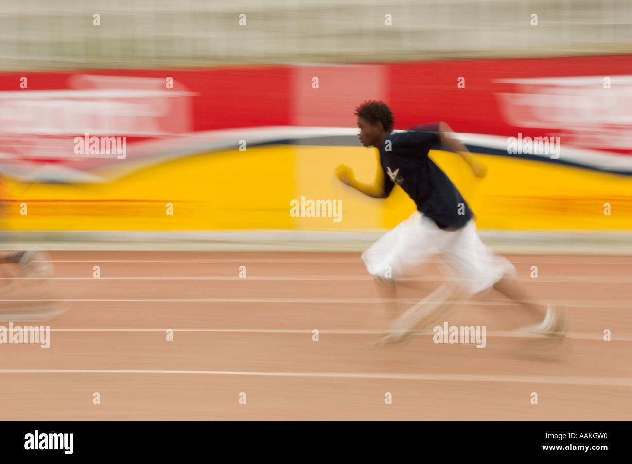 Student competes in relay race - Stock Image