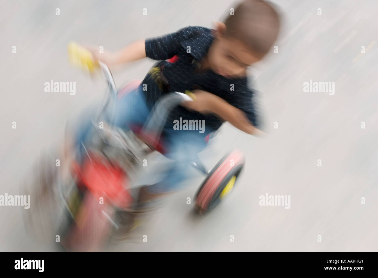 Blurred movement on a tricycle Stock Photo
