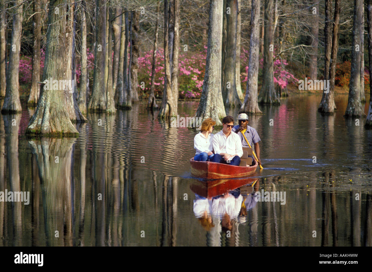 1980s TOURIST COUPLE IN WOOD GUIDE BOAT CYPRESS GARDENS CHARLESTON ...