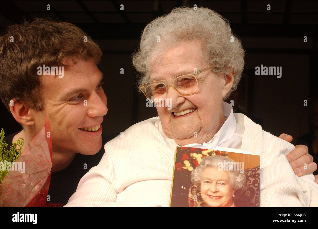 A WOMAN WHO IS 100 YEARS OLD SHOWS CARD SENT TO HER FROM THE QUEEN