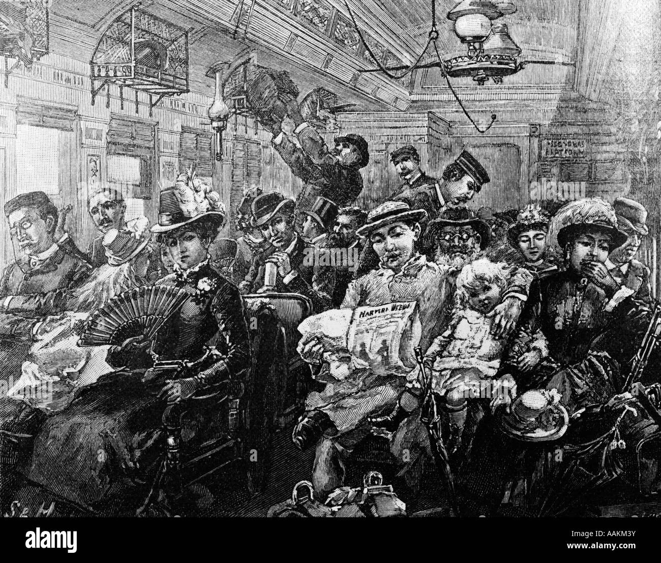 1880s ILLUSTRATION CROWDED PASSENGER CAR 19TH CENTURY TRAIN FROM HARPERS MAGAZINE AUGUST 1885 - Stock Image