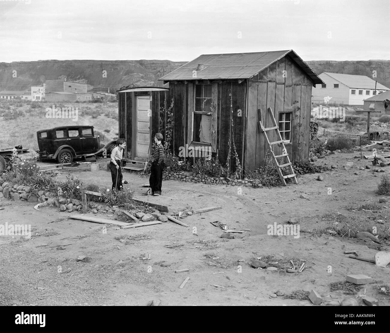 Houses With Porches 1930s Poverty Scene With Two Boys Playing In Front Of