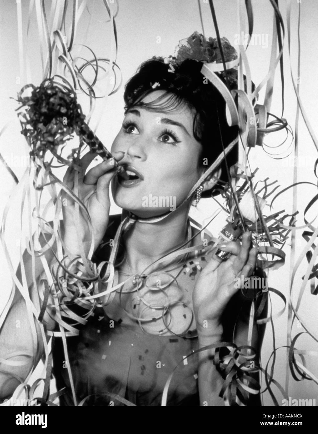 http://c8.alamy.com/comp/AAKNCX/1950s-1960s-woman-blowing-noisemaker-amid-party-confetti-and-streamers-AAKNCX.jpg