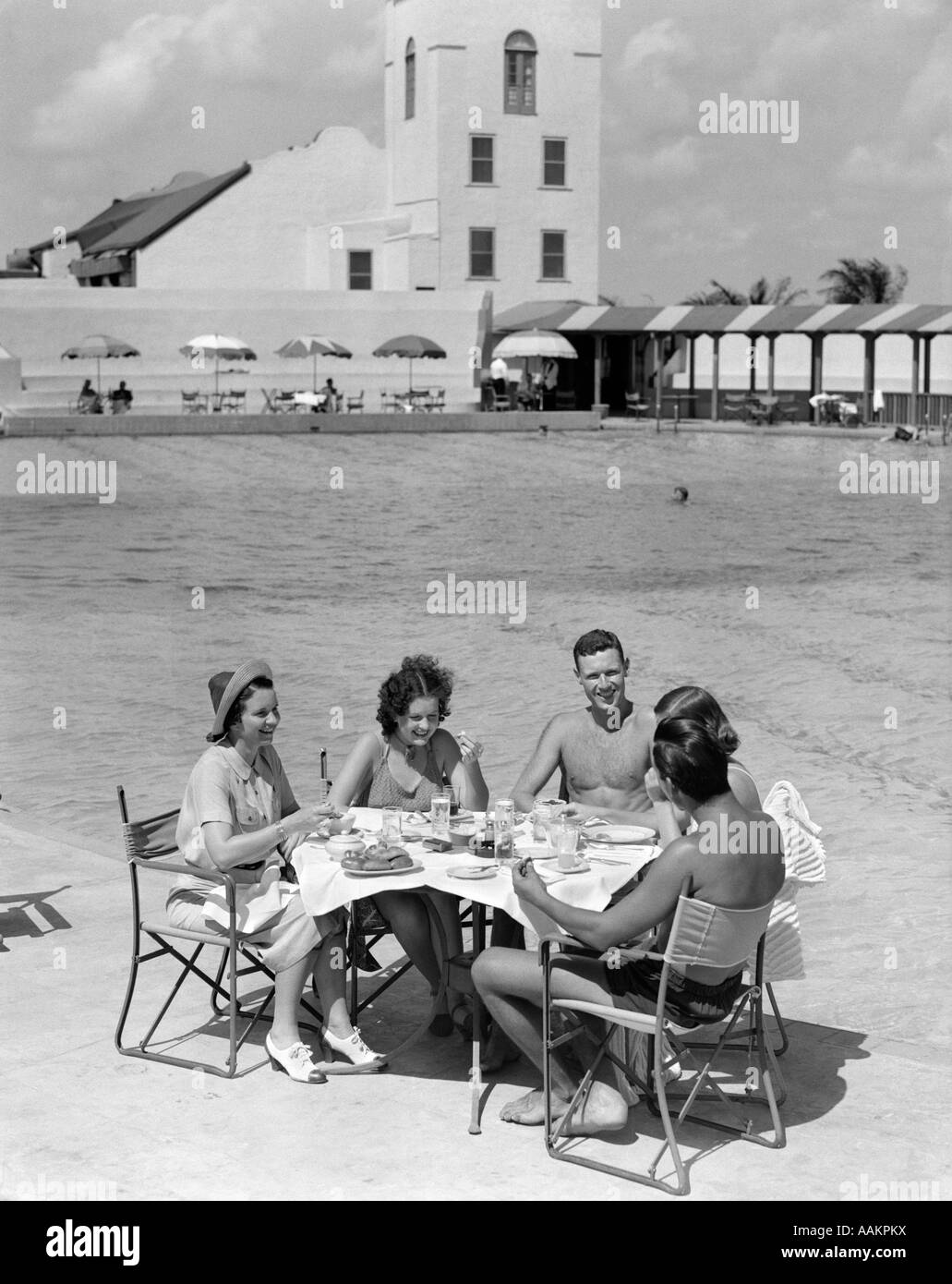 1930s GROUP 5 MEN WOMEN DINING POOL POOLSIDE TABLE VACATION HOTEL TRAVEL  FOOD MIAMI FLORIDA