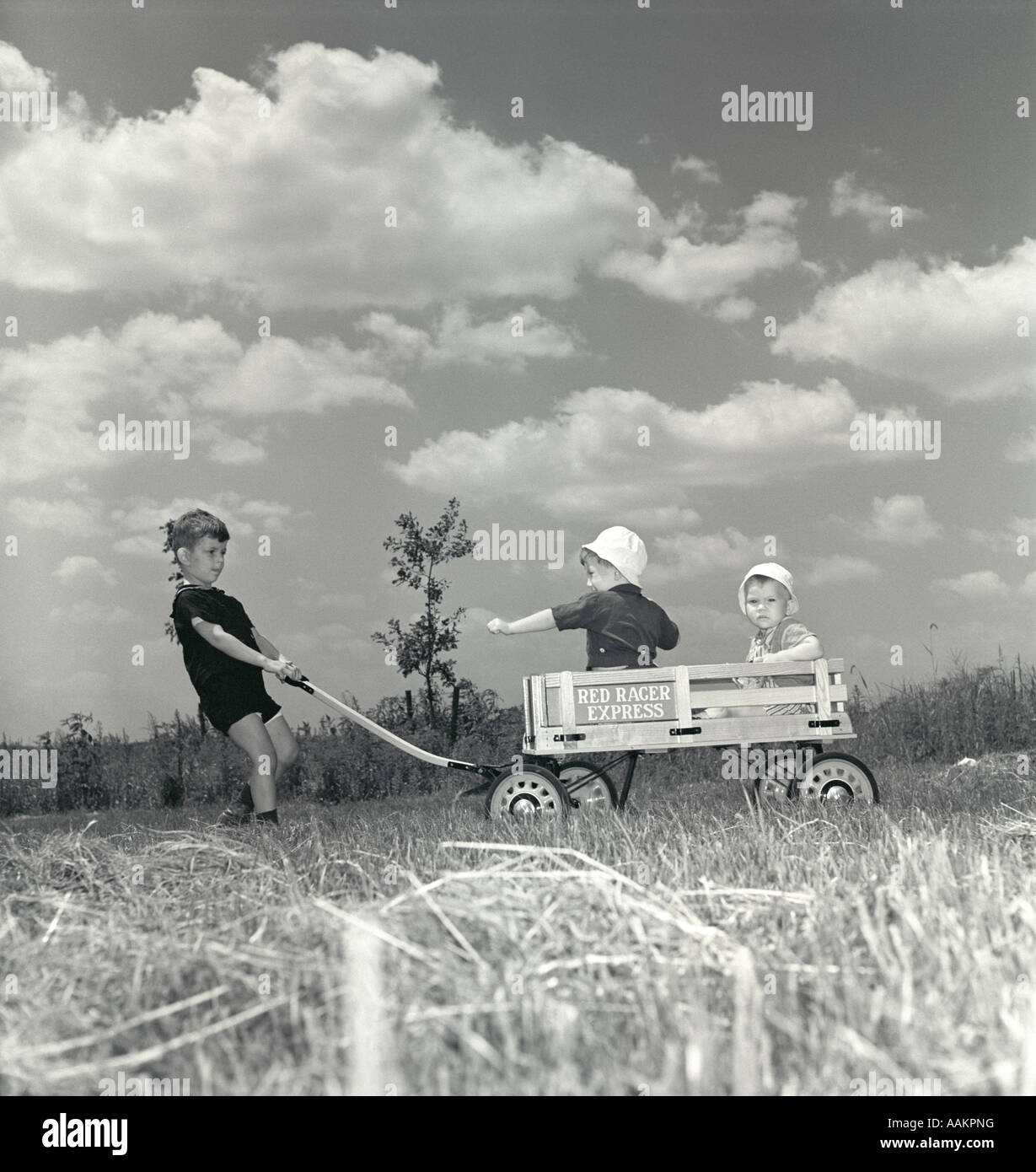 Boy Pulling Wagon : S little boy pulling red racer express wagon with two