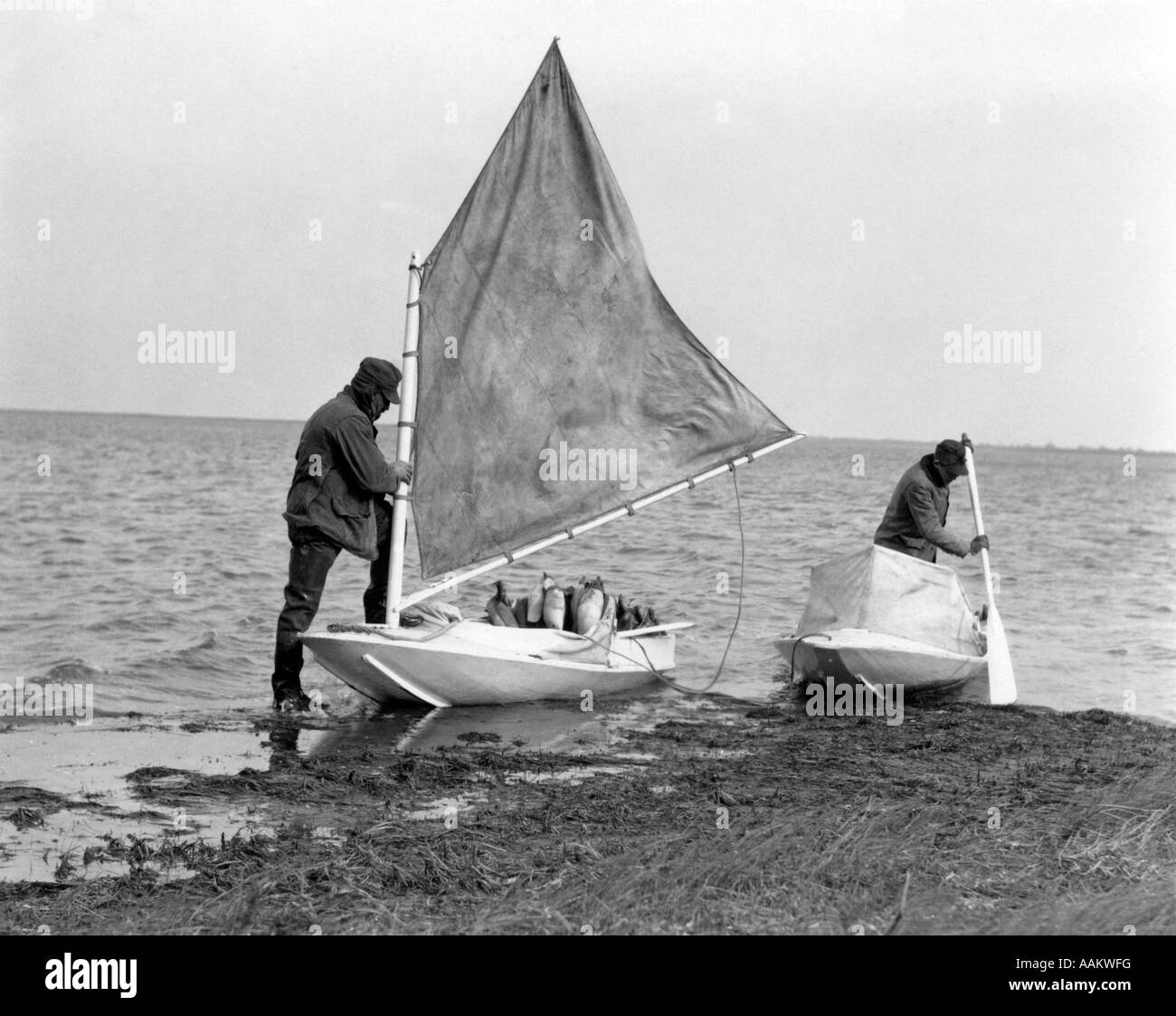 1930s TWO MEN SMALL BOATS DUCK DECOY PREPARING TO GO DUCK ...