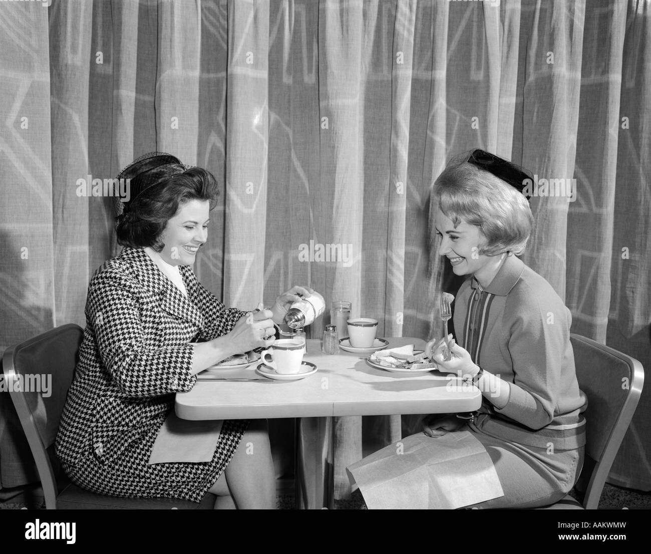 1960s TWO WOMEN HAVING LUNCH IN COFFEE SHOP RESTAURANT ...