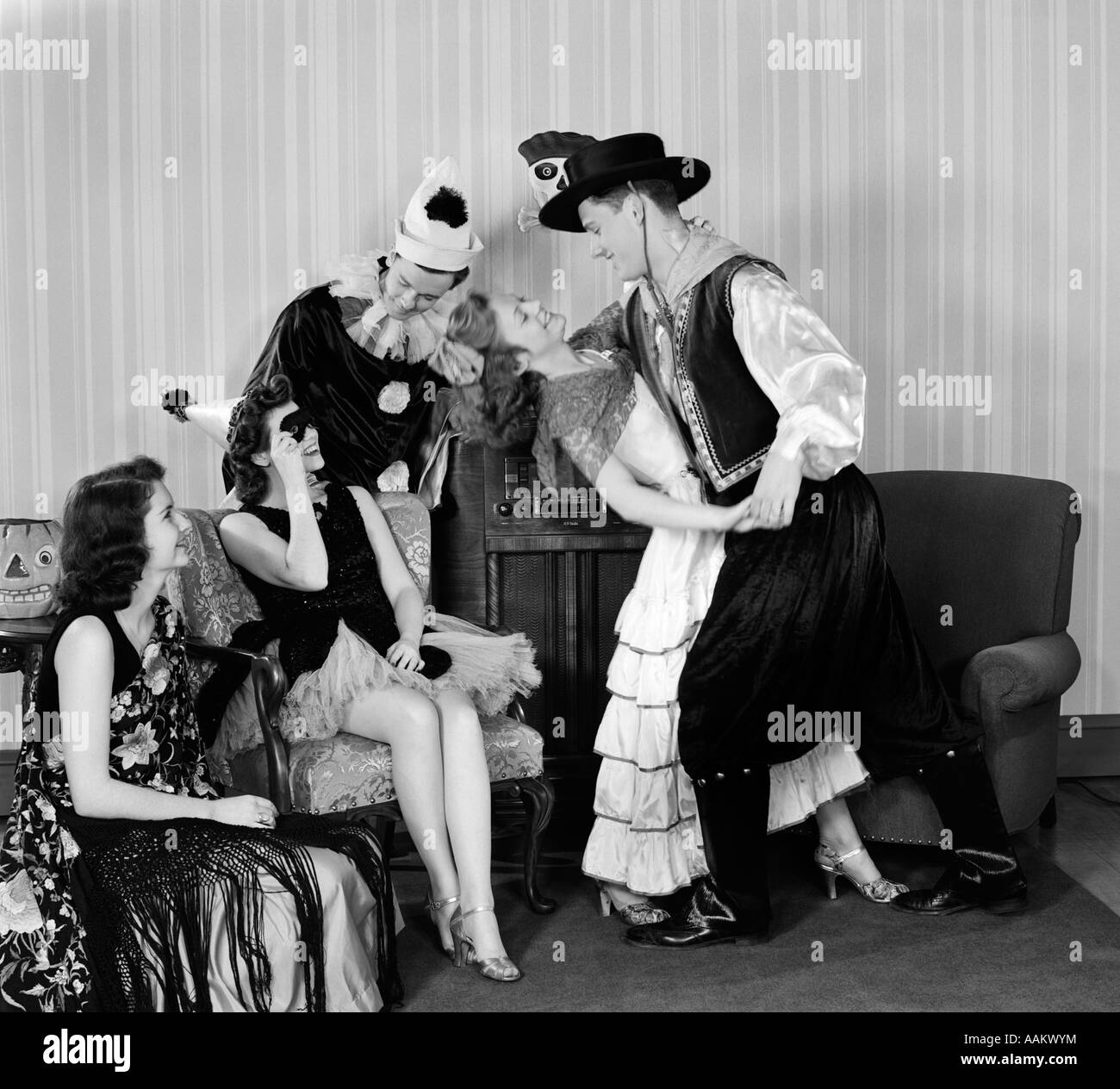 1930s 1940s YOUNG COUPLES DRESSED IN COSTUMES DANCING AT HOME HALLOWEEN PARTY - Stock Image  sc 1 st  Alamy & Man In 1940s Suit Stock Photos u0026 Man In 1940s Suit Stock Images - Alamy