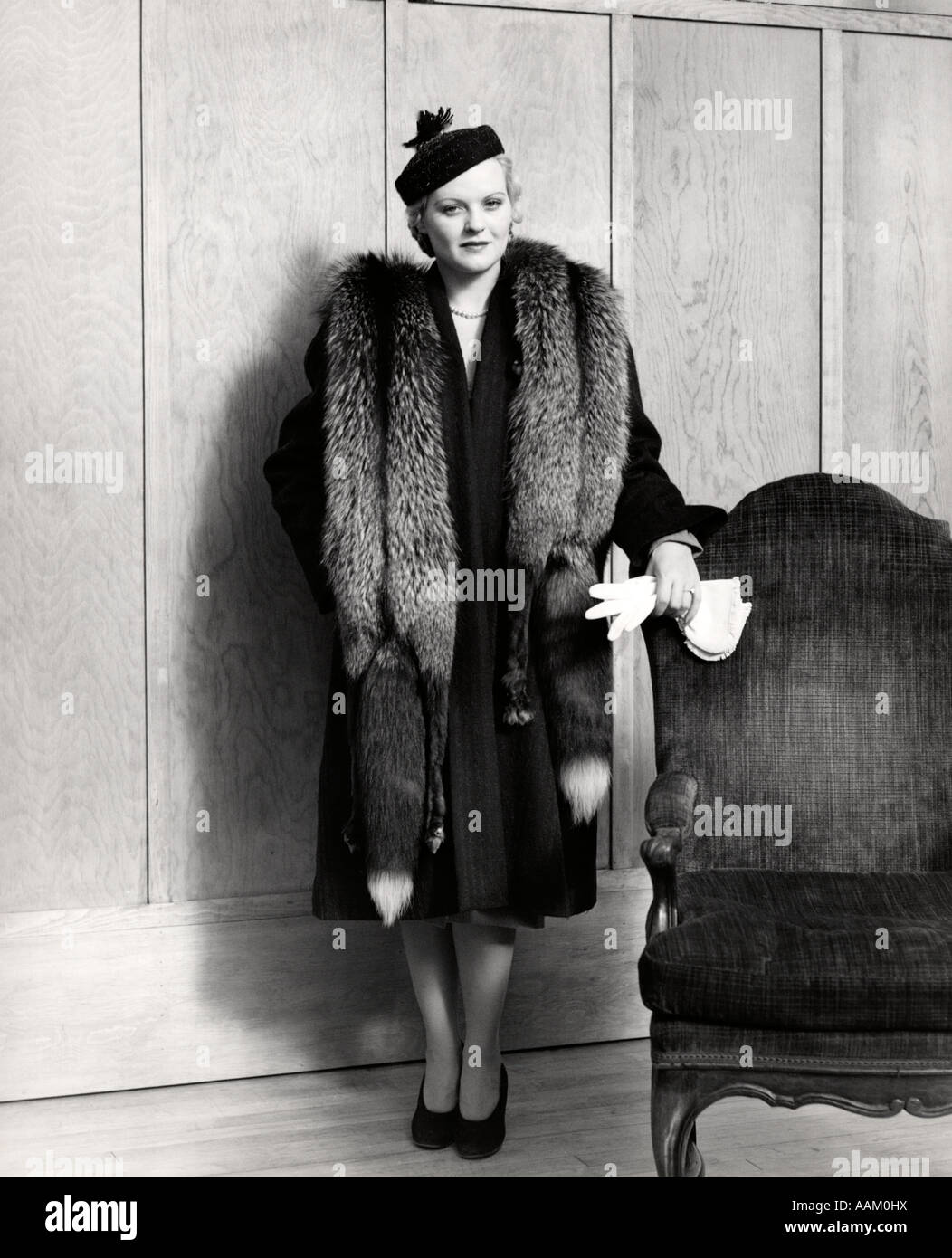 1930s Woman Wearing Long Coat And Fox Fur Stole Holding