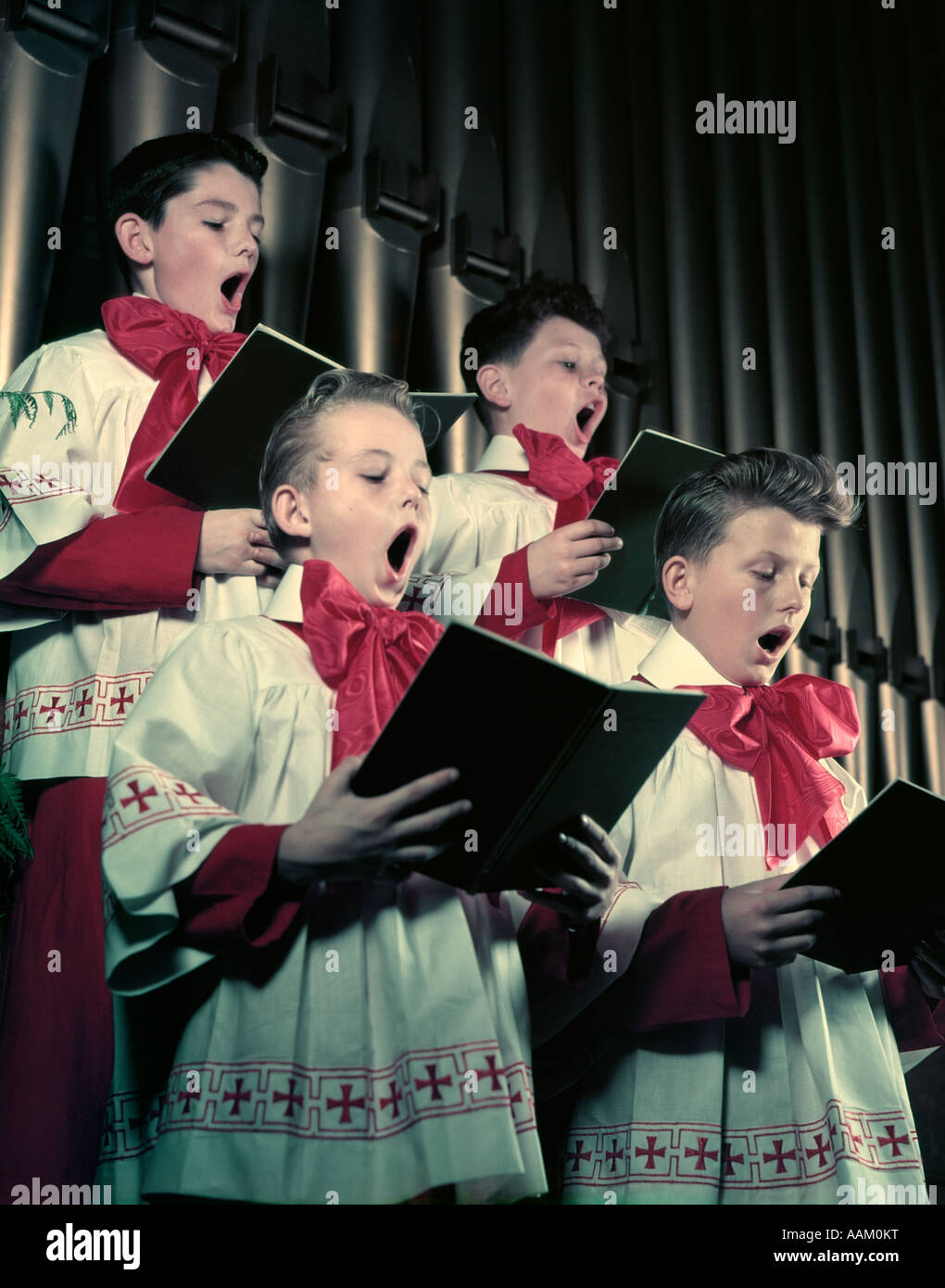 1950s Four Choir Boys In Red And White Robes Singing In Front Of Stock Photo Alamy
