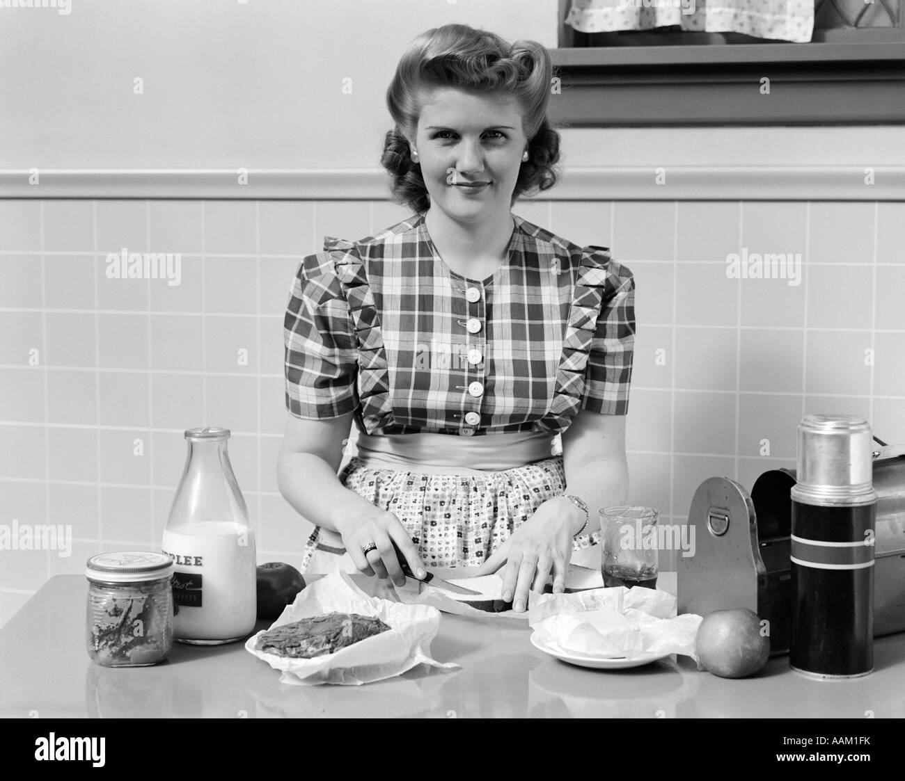 1940s WOMAN SMILING IN KITCHEN MAKING SANDWICHES FOR METAL LUNCH BOX ...