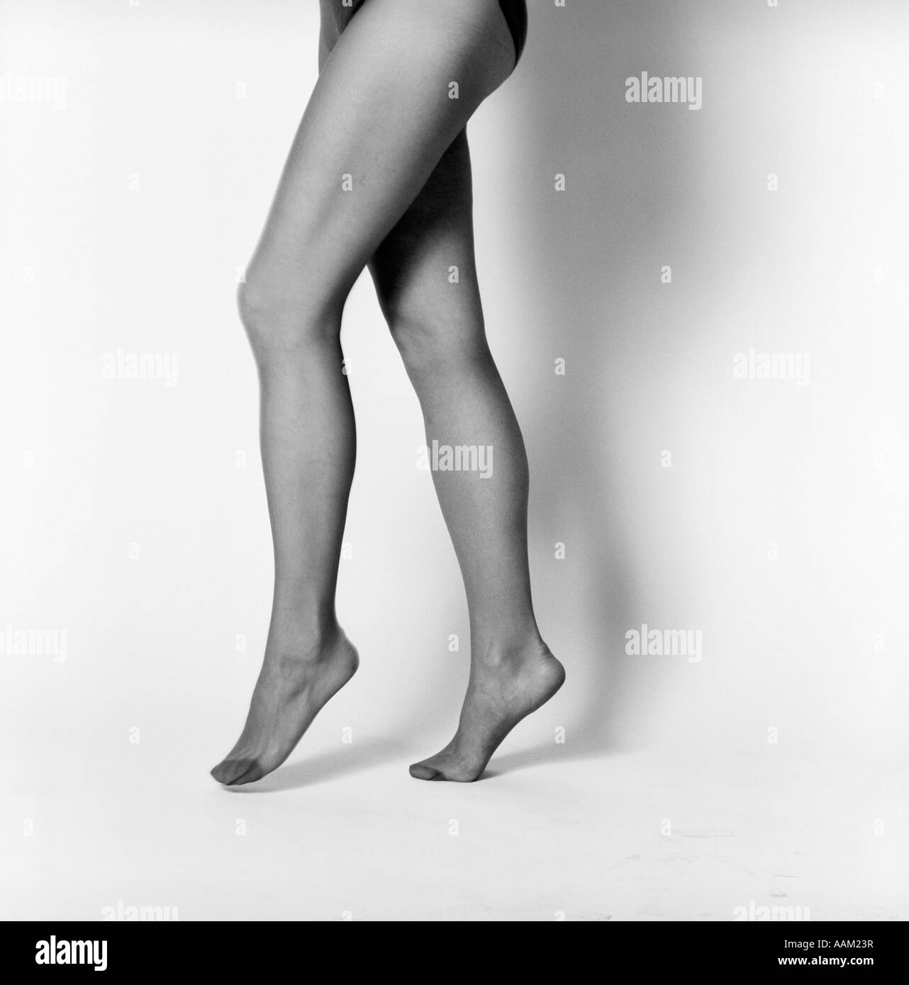 5ee1a79caeccc 1970s WOMAN'S LEGS FROM HIP DOWN STANDING ON TOES WEARING PAIR OF PANTY  HOSE - Stock