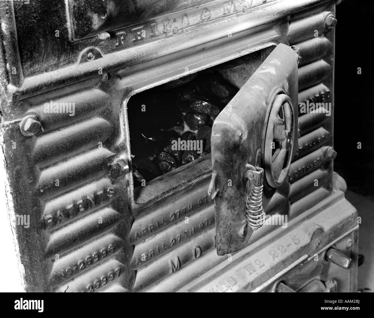 1920s DOOR ON COAL STOVE HEATER - Stock Image