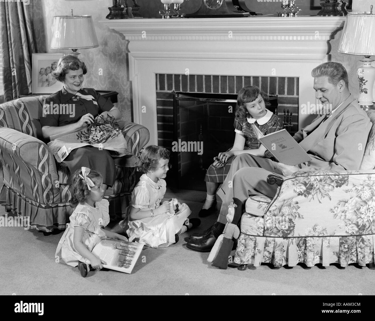 1950s Family Of Five Mother Father And Three Girls Sitting