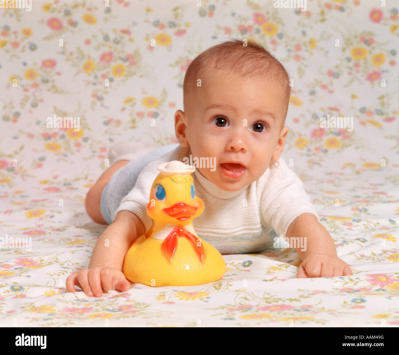 1970s BABY BOY WITH RUBBER DUCKY - Stock Image