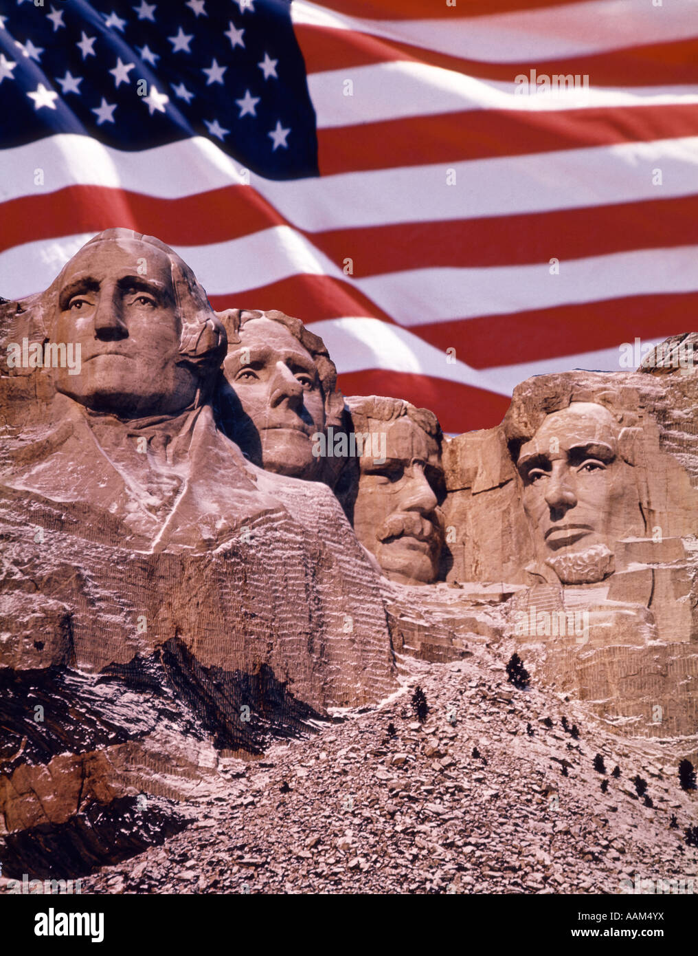 MOUNT RUSHMORE WITH AMERICAN FLAG IN BACKGROUND - Stock Image
