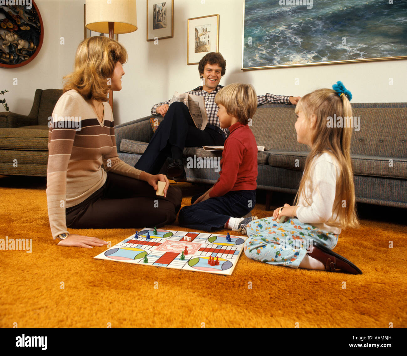1970 1970s Family Mother Father Boy Girl Playing Game Living Room