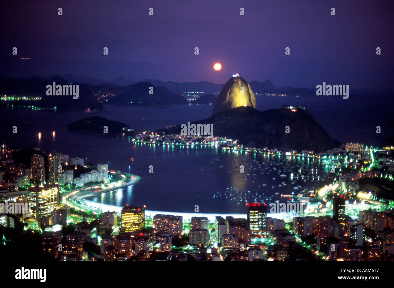 Sugar Loaf Mountain and Botafogo inlet Rio de Janeiro skyline at night with moon Brazil Stock Photo
