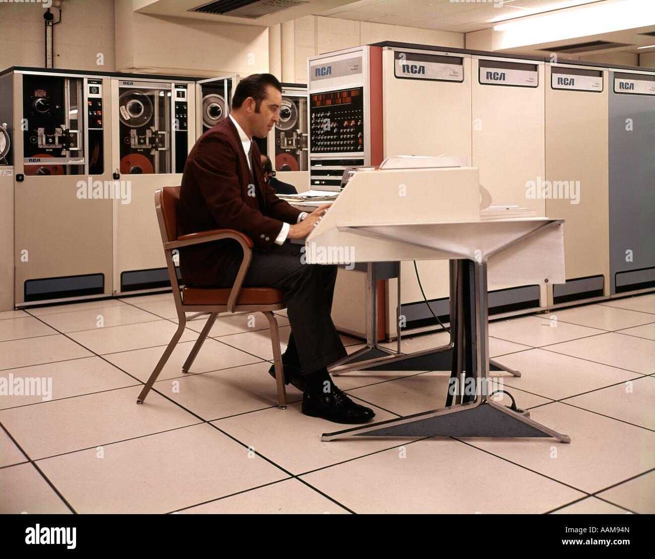 1970s MAN SITTING COMPUTER WORK STATION RCA MAIN FRAMES DATA Stock ...