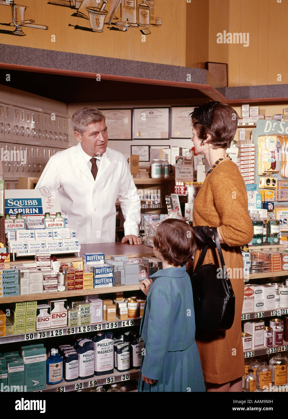 561526272ce 1960s MOTHER AND DAUGHTER IN PHARMACY TALKING TO DRUGGIST THREE MAN WOMAN  GIRL MEDICINE VITAMIN
