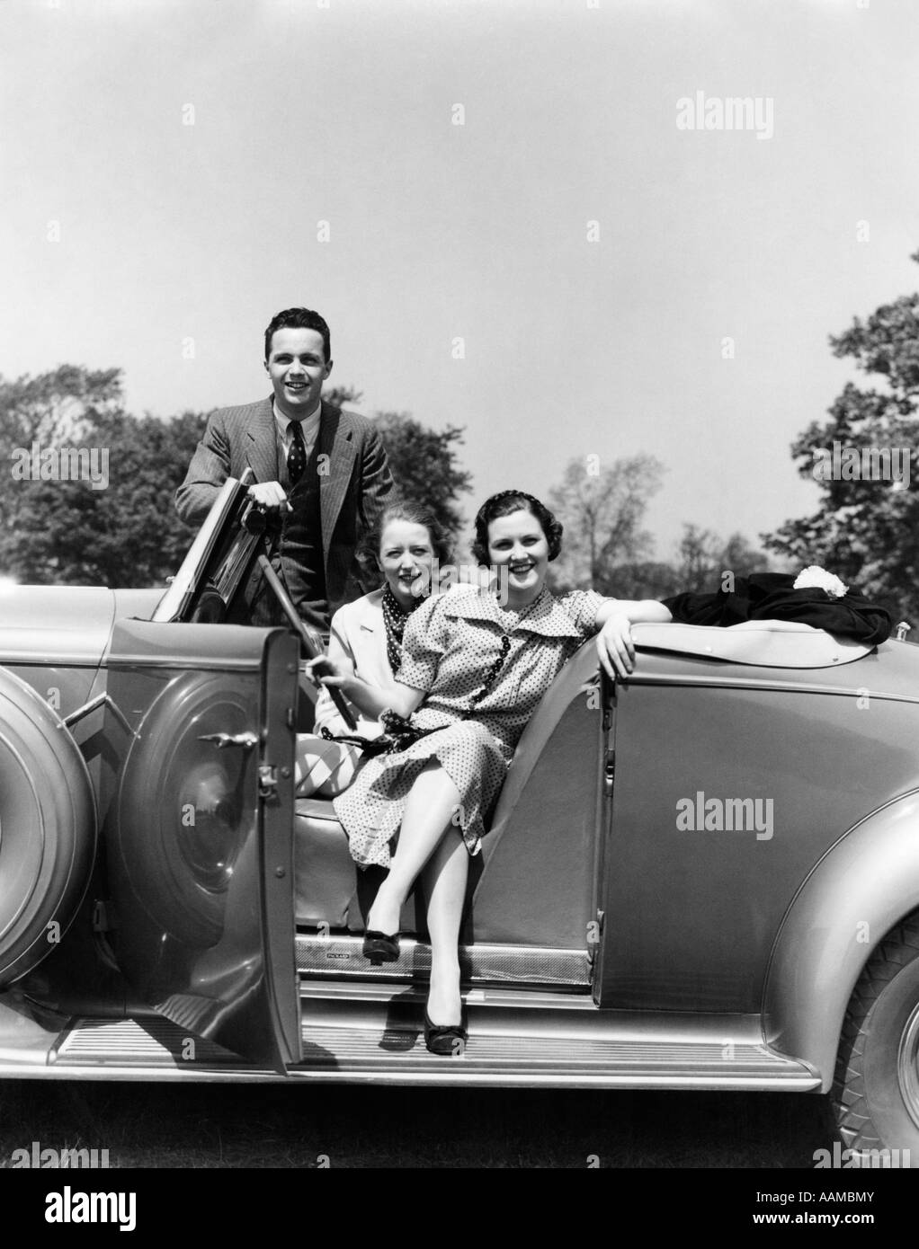 1930s RETRO WOMEN MAN CAR SMILE CONVERTIBLE SUIT Stock Photo ...