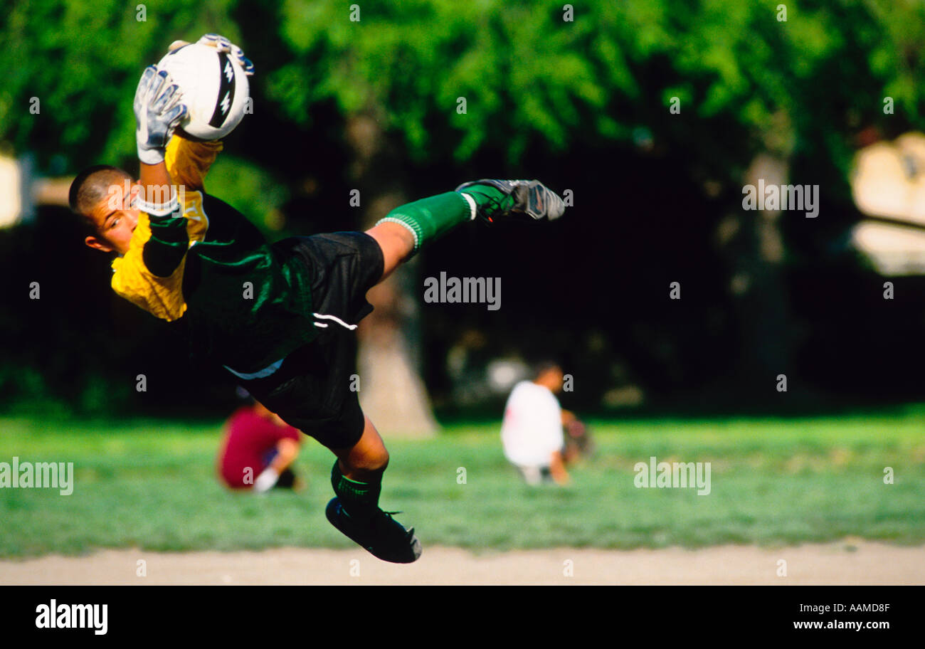 soccer goalee diving to make a goal save football  - Stock Image