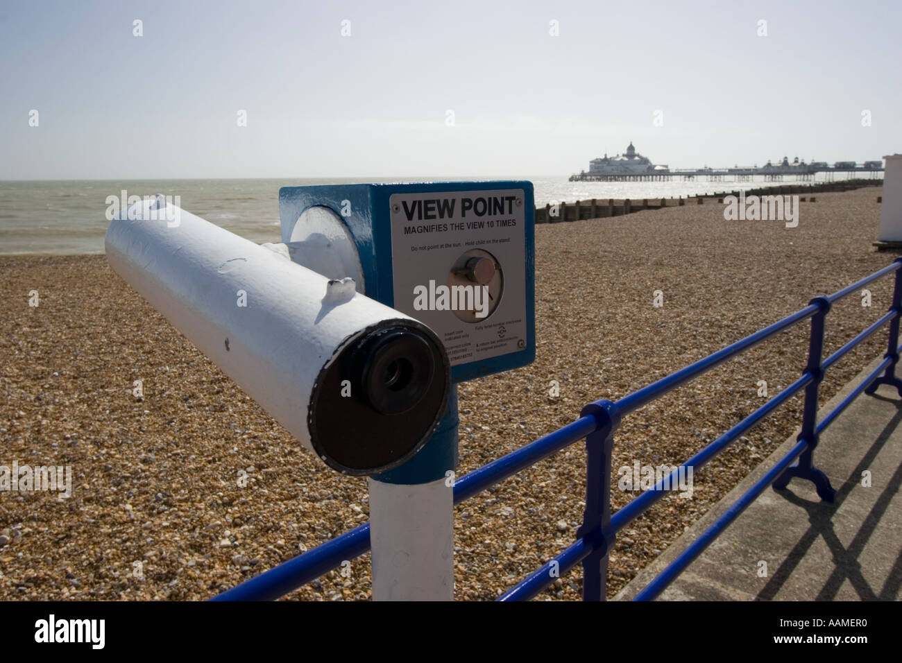 Telescope overlooking the beach and sea from Eastbourne pier Stock Photo