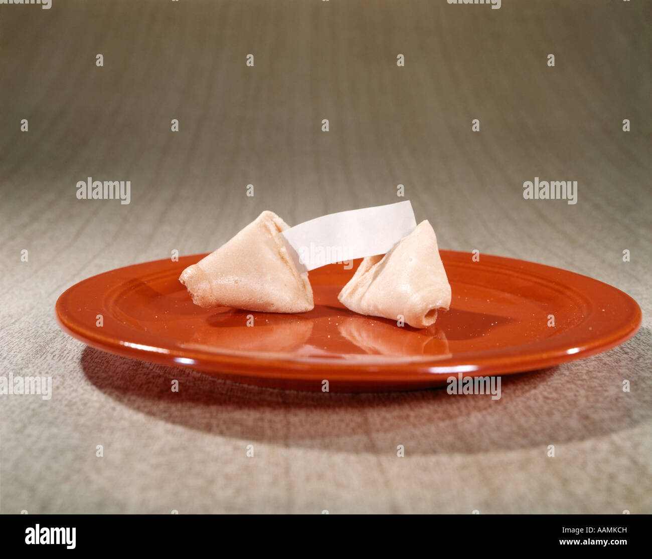 CHINESE FORTUNE COOKIE ON RED PLATE - Stock Image
