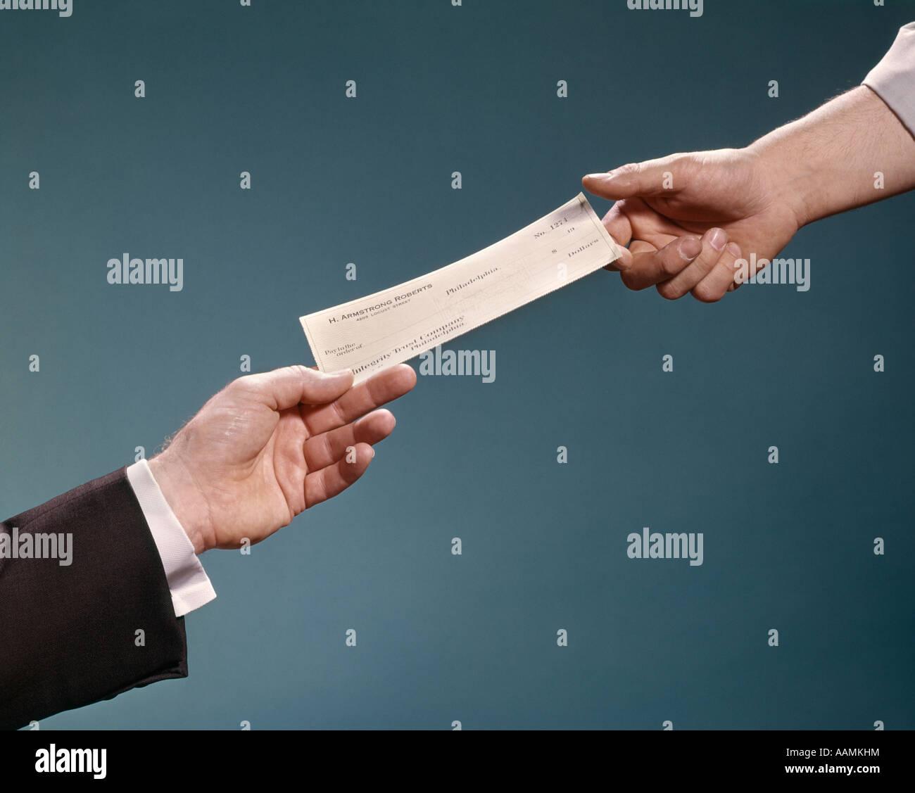 RETRO HANDS CHECK TRANSACTION MONEY EXCHANGE - Stock Image