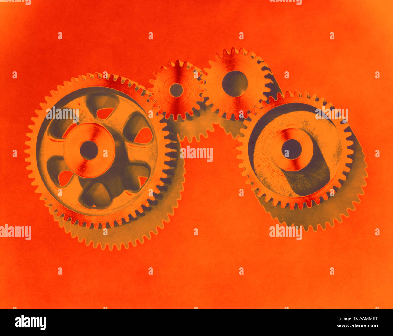 1970s PATTERN OF GEARS POSTERIZED COLOR ORANGE GREEN INDUSTRY - Stock Image
