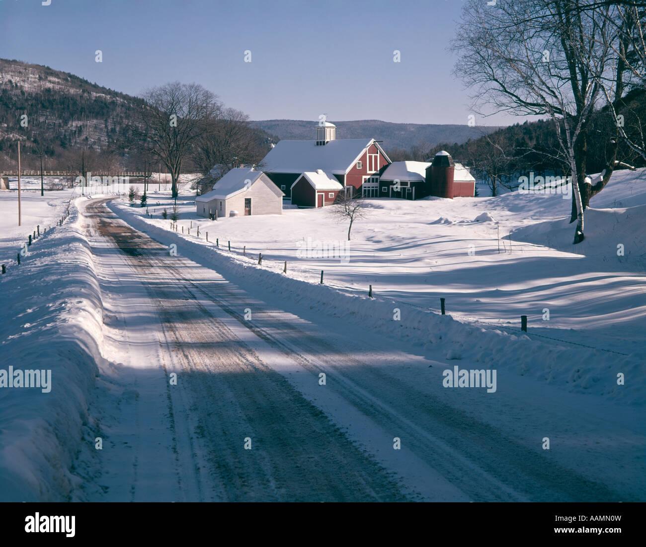 WINTER SCENE ROAD AND BARN - Stock Image