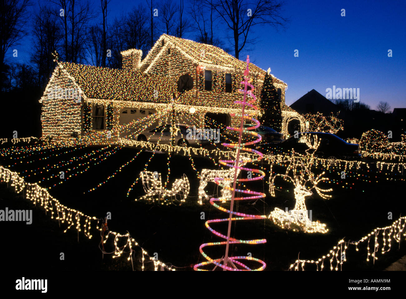ENTIRE HOUSE AND YARD DECORATED WITH CHRISTMAS LIGHTS   Stock Image