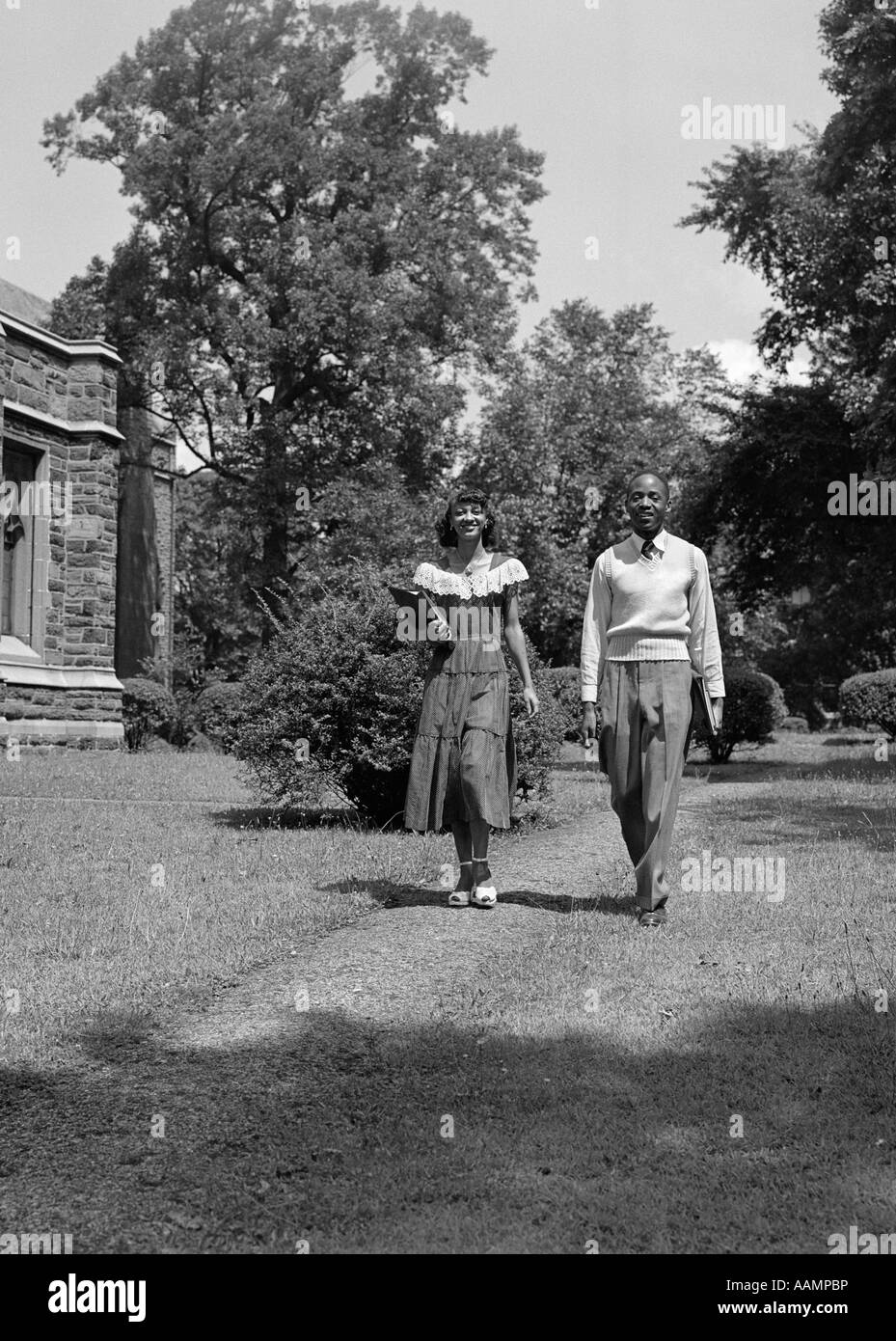 1940s 1950s AFRICAN AMERICAN COLLEGE COUPLE WALKING ON