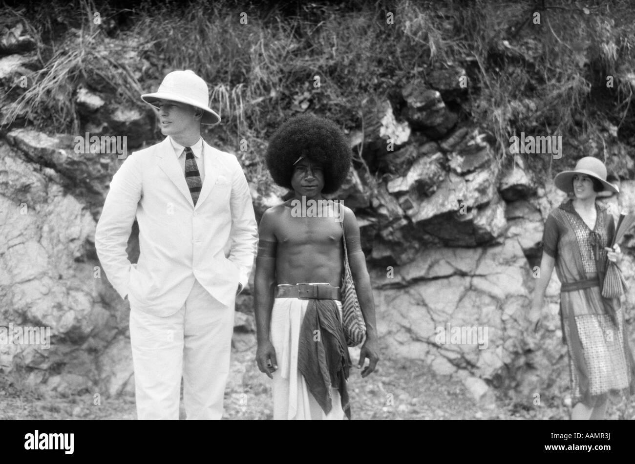 61a590e3d8c47 1920s 1930s MAN IN WHITE SUIT PITH HELMET WITH NATIVE GUIDE PORT MORESBY  NEW GUINEA -